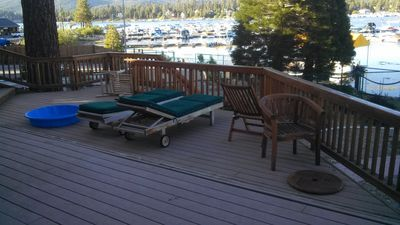 Teak furniture and loungers on the deck.