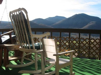 Visitors love relaxing on the porch swing looking at the mountains.