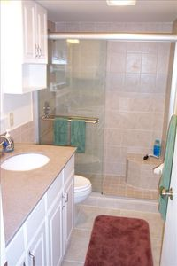 New bath with tile and glass, walk-in shower w/ seat - unit 3307.