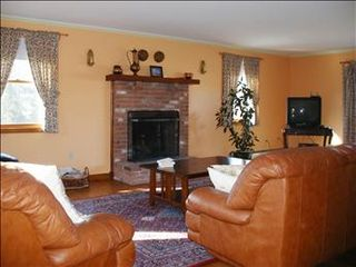 East Orleans house photo - Comfortable seating, books, Internet, and cable TV in living room.