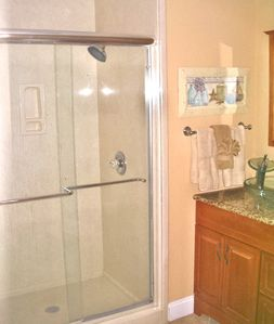 Third bath, sink with granite top and modern glass vessel sink.
