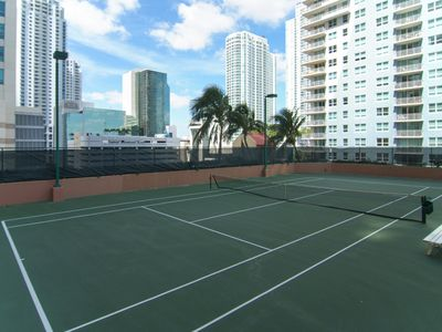Tennis Court adjacent to pool deck available for reservations at the Concierge