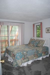 Sunny bedroom on second floor with Queen Bed.