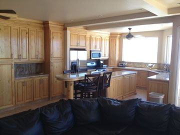 Large kitchen with everything needed to cook a gourmet meal and Bar seating.
