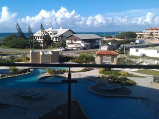 Aruba condo photo - Amazing view of pool and Eagle Beach from balcony !!