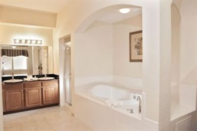 Large master bathroom with granite counters, jacuzzi tub and walk-in-shower