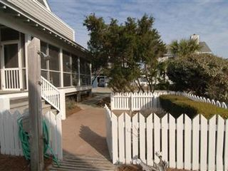 Bald Head Island house photo - Balvenie Courtyard and screened in porch with hammock- sheltered by the cedars