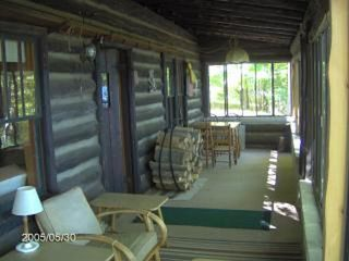 Honor cabin photo - Large Screened in Porch which faces the Lake