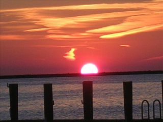 Crisfield house photo - Relax on deck or enclosed porch and enjoy beautiful sunsets