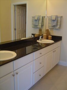 Double Vanity With Granite Countertop in Master BA