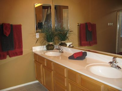 Luxury master bath with double sinks, large shower, and private water closet.