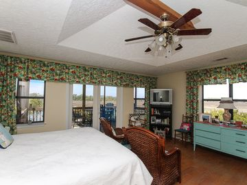 Tybee Island house rental - Master bedroom with king bed opens onto the top floor screened in balcony/deck.
