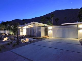 Palm Springs house photo - Front elevation with two car garage and deep driveway