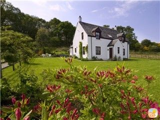 Relax in the garden at Seabank Farmhouse with stunning views over the Loch