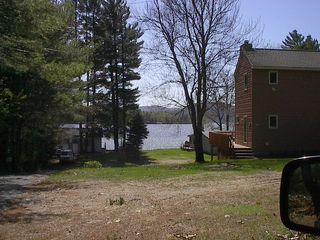 Newfound Lake house photo - private beach parking to unload cooler and chairs for the day . 2 cottages away