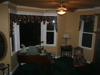 Auburn house photo - The Baby Grand Piano beckons from a Bay Window of the Living Room.