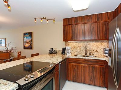 Kitchen with Granite Counter Tops, fully stocked with pots and pans, blender.