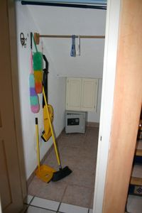 Large walk in storage closet with personal safe under stairwell