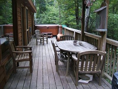 Enjoy outdoor dining and soaking in the hot tub while listening to the river