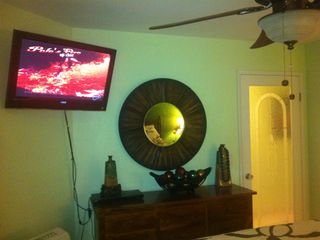 32 inch HDTV with DVD and over 150 DVD's