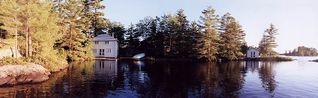 Stoney Lake cottage photo - Boat-house, Main Building (in trees, center), Sleeping Cabin (on point, right)