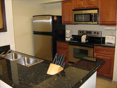 Beautiful kitchen with granite counter tops and stainless steel appliances!