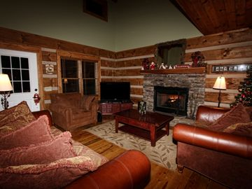 "Cozy living area surrounding hand-stacked stoned fireplace and 50"" HD television"