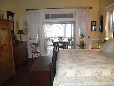 Guest Bedroom French doors to screened porch View of salt marshes