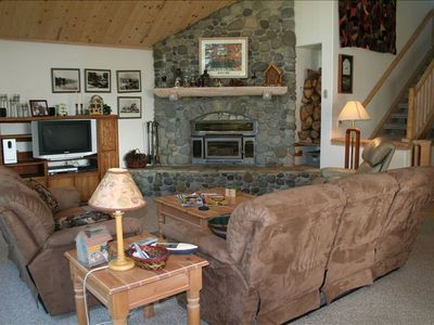 Great Room with cozy wood burning fireplace & plenty of seating for large groups