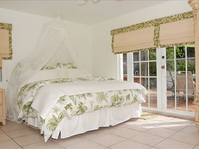 Master suite with French doors leading to Pool/Deck