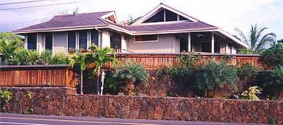 Welcome! This view depicts the Hawaiian Style home and the lovely rock wall.