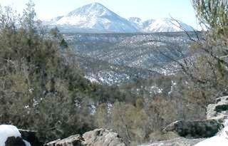 View of Sleeping Ute Mountain from the property - Mesa Verde cabin vacation rental photo
