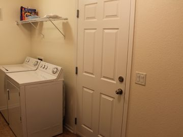 Laundry room with full sized washer and dryer