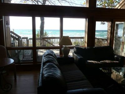 View of lake from the living room, deck adjoins  and hot tub just down steps.