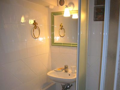 The downstairs shower room with a wc