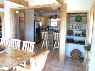 Sullivan lodge photo - Looking back at the Beautiful Log Decor kitchen.....family gatherings & dinners.