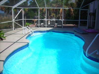 Screened in pool for your comfort.