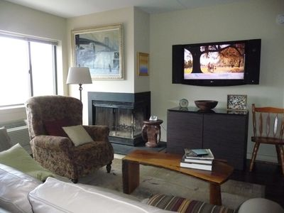 Wood Fireplace and large TV in living area