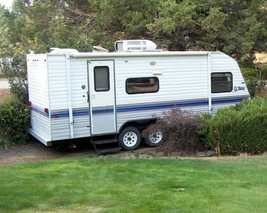 Our 22' trailer fits on the side driveway & there is room for a larger size