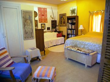 Master Bedroom with California King bed and convenient sitting, reading area.