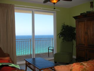Splash Resort condo photo - Sit on the sofa or love-seat in the living room and watch the emerald waters.