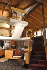 Telluride chateau / country house photo - The floating staircase at the Retreat is a hallmark of mid-century modernism.