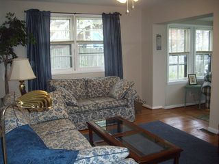 Colonial Beach cottage photo - Livingroom features cable tv, dvd, wifi. puzzles and board games.