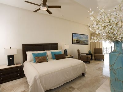 Master Bedroom with Sitting Area, Walkout to Balcony, Flat Screen TV &DVD player