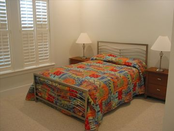 One of two queen-size bedrooms.