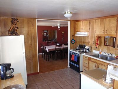 Kitchen includes microwave & dishwasher. Separate dining room w/ seating for 8.