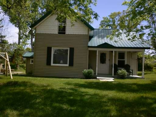 Cozy older style house situated in the city of Park Rapids with a river view