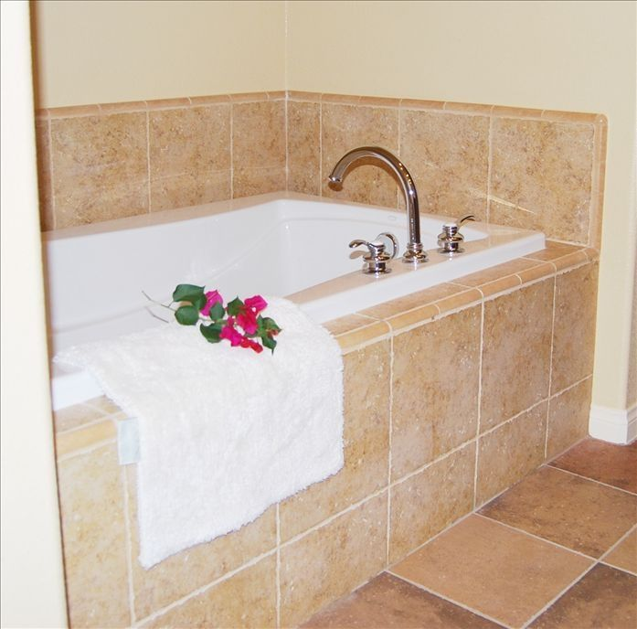 Relax in this deep soak tub and large stall shower.