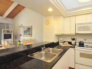 Napili condo photo - Full service kitchen with stove, oven, dishwasher, granite counters, fridge, etc
