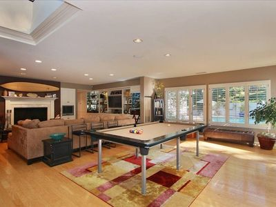 Pool Table can convert to Ping Pong off Kitchen with French Doors open to pool.